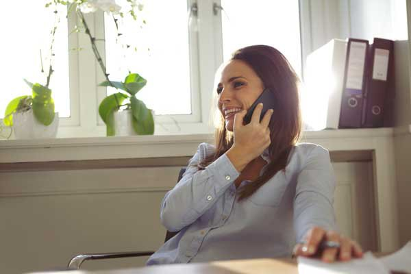 business phone service: woman in home office