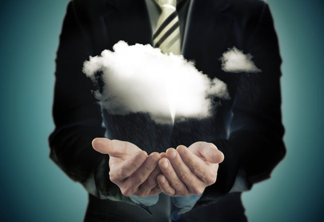 Business VoIP Phone Service: Man holding a cloud image