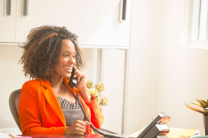 Happy woman talks on the phone