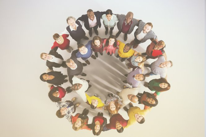 An overhead view of employees connected in a circle, representing enterprise cloud solutions.