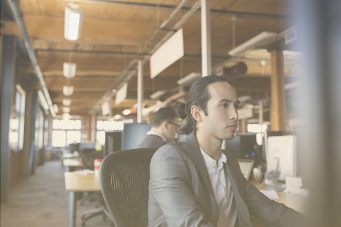 An insurance company employee using the latest technology in communication.
