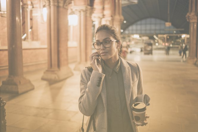 A woman talking on her mobile phone, thanks to advances for telecommunications in business.
