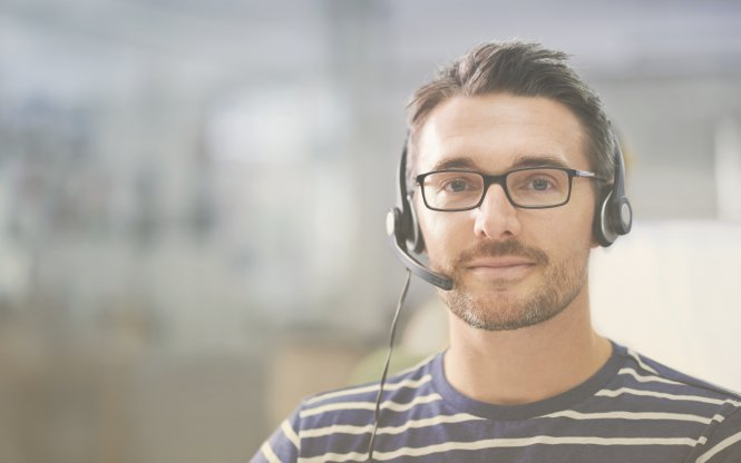 A sales team member on a headset, representing the impact of technology on business communication.