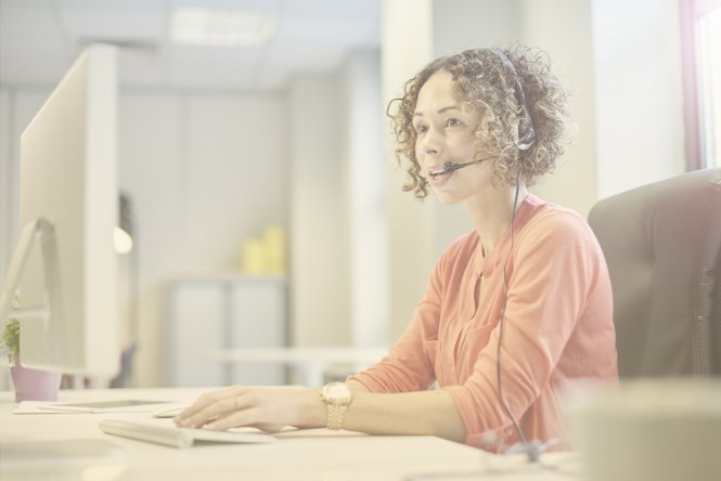 Woman in call center using Zendesk integration