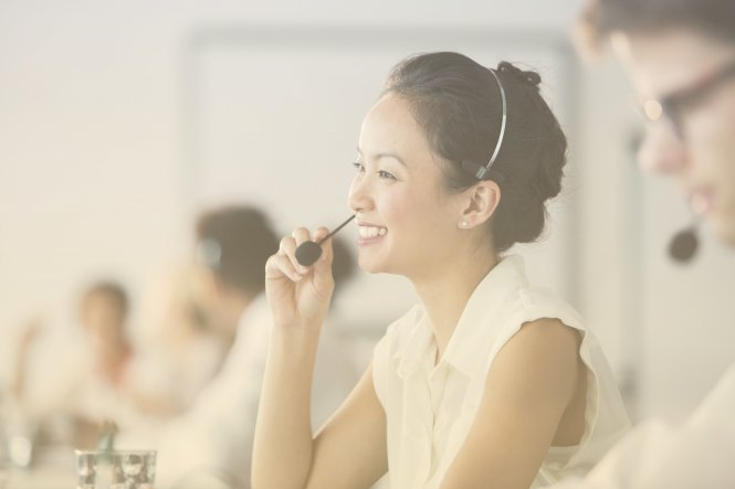 An employee happily works in an AI contact center