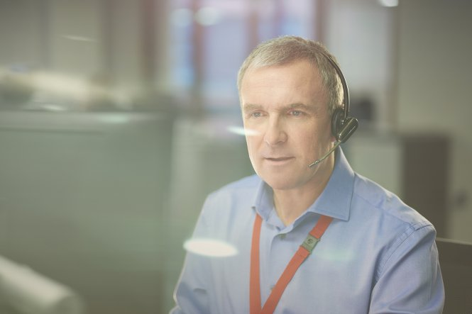 Man working in a cloud contact center.
