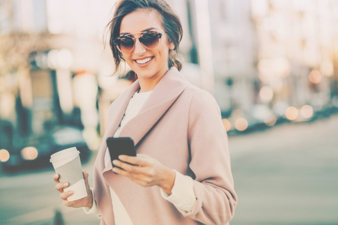 A woman uses two-way text messaging on her smartphone to contact her credit union