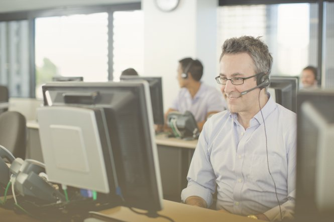 Gamification in business in action: Contact center agent sitting at his computer