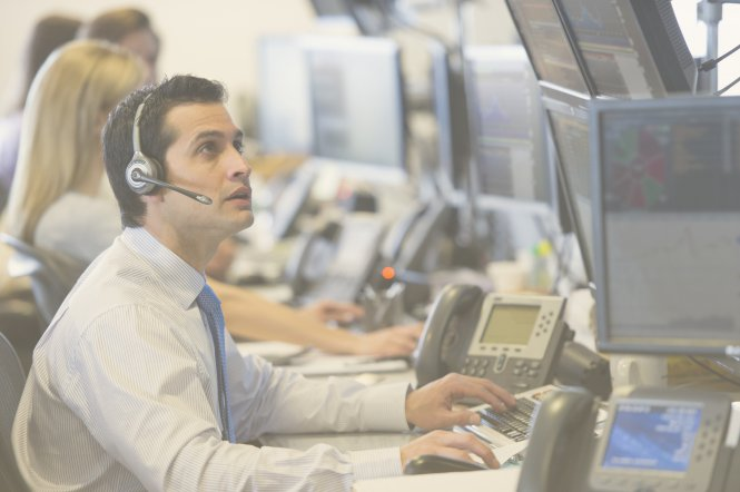 Employee at a finance firm using unified communications to improve work productivity