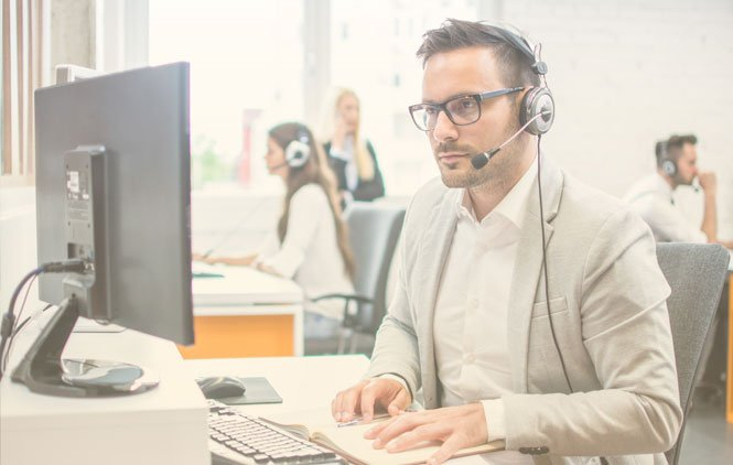 Guy Looking intense while AI saves the Contact Center