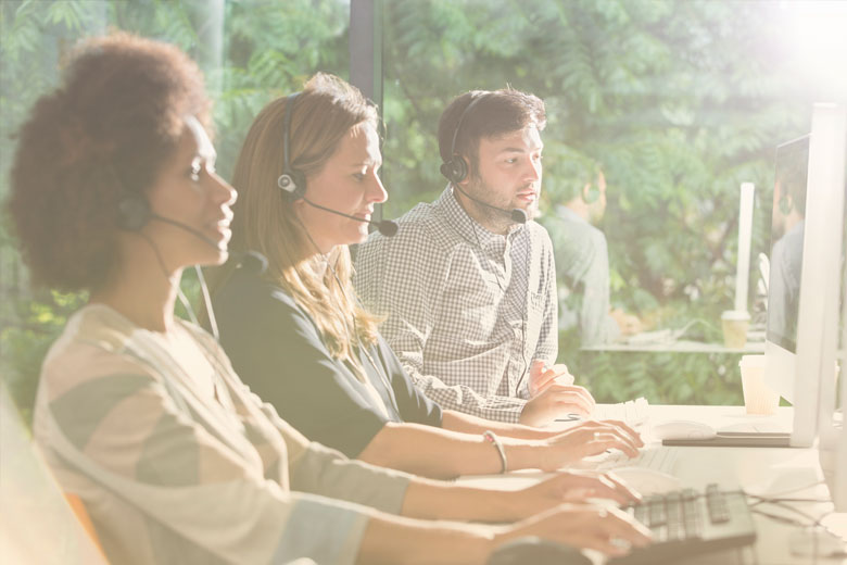 Contact center employees using UCaaS technology to provide customer service