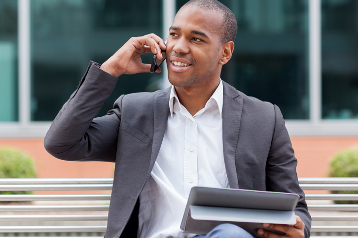 Unified Communications: image of man on cell phone with  tablet