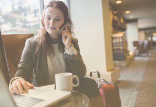 A woman using business communication and technology to more effectively track her billable hours.