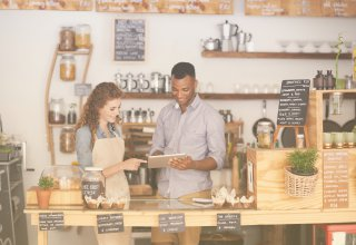 A man and woman using personalization in retail to provide a superior customer experience.