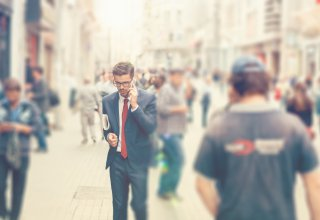 Salesman fielding a call on the go with Oracle cloud integration