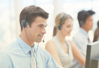 Customer service associates work in a call or contact center.