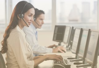 Two customer care specialists working in a social media contact center