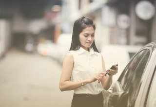 Car dealership marketing sends a woman targeted information on buying a car to her smartphone