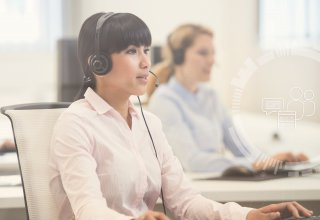 A woman wearing a phone headset providing airline contact center solutions to a customer