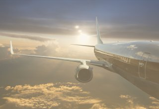 A plane soars through the air, passengers having received excellent travel communication