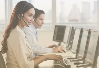 Call center employees enjoying the benefits of SIP trunking as they answer calls