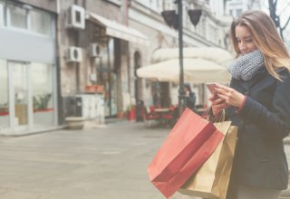 Woman using her smartphone to improve her shopping experience