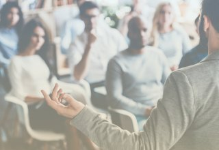 Professor teaching in a classroom influenced by digital transformation