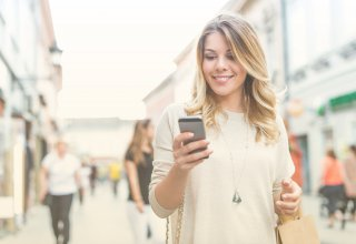 Shopper on mobile device engaging with a business' lead nurturing strategy
