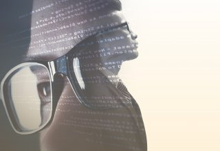 Close-up of person's face laid on top of code and a person's torso — UCaaS use cases