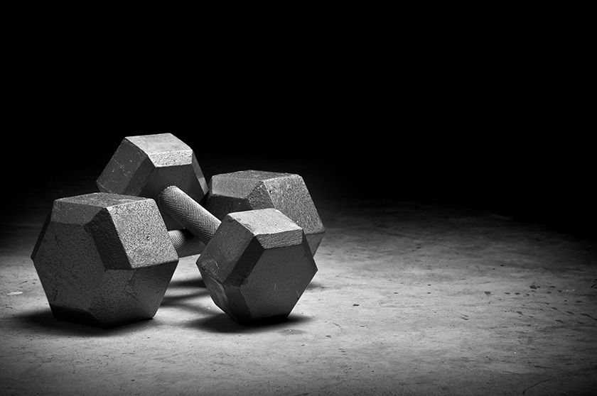 Dumbbells isolated on grunge surface.